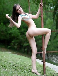 Laconic titted young beautiful incomprehensible teen posing naked open-air